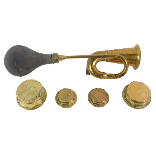 3019 - A vintage brass car horn, together with four hub caps, one engraved G Hurt, Builder, Barnby Moor. (5...