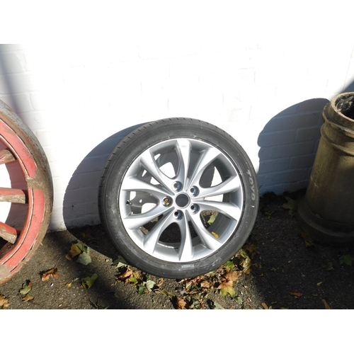 3051 - A tyre and wheel trim for a Mazda 3 2l Sport 2010....