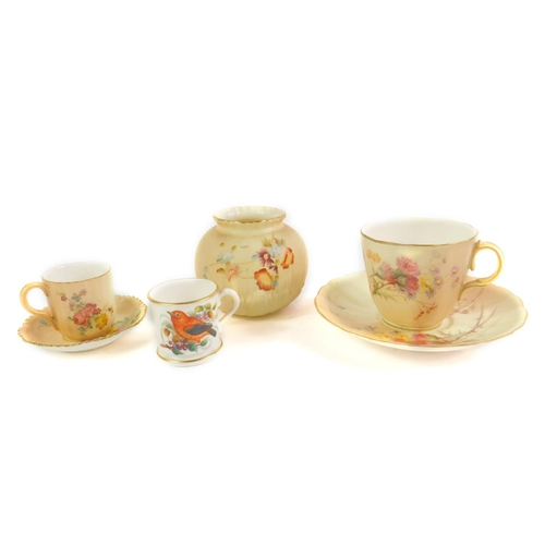 25 - A Royal Worcester porcelain miniature mug c1883, painted with a bird and flowers, printed mark, toge...