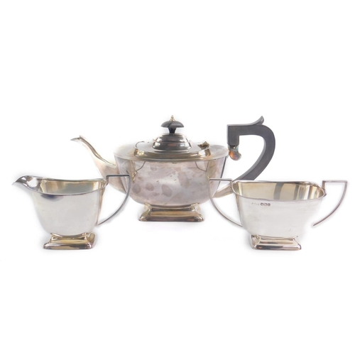 3 - A silver three piece tea set, comprising teapot, cream jug and sugar bowl, maker BRS, Sheffield 1962...