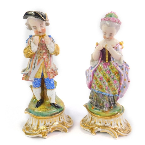 36 - A pair of Paris porcelain late 19thC figures of a young gallant and lady, each modelled standing aga...