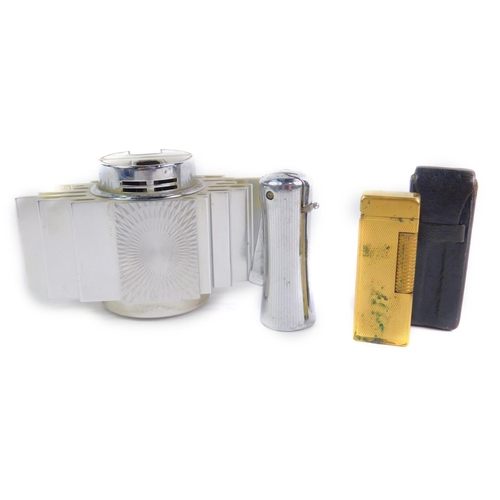 57 - A Dunhill Rollagas gold plated pocket lighter, US Patent RE24163, leather cased, together with a Ron...