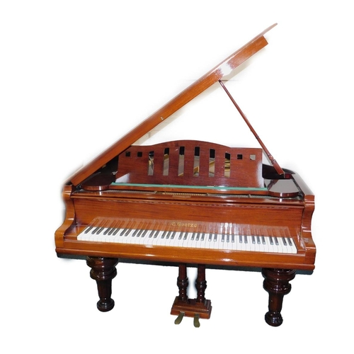 8 - A mahogany cased baby grand piano by C Goetze, patent no 90034, iron framed and cross strung, no 109...