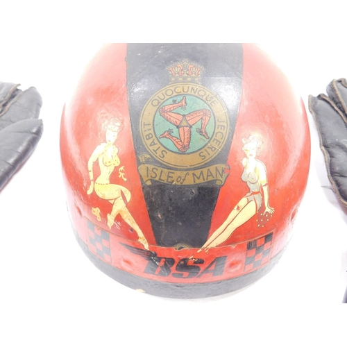 3008 - An MFG The 'Centurion' motorcycle helmet, painted red and black, fitted with a leather headband and ...