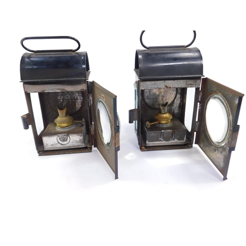 3028 - A pair of black painted railway lamps with Sherwood Patent burners, 18.5cm H....
