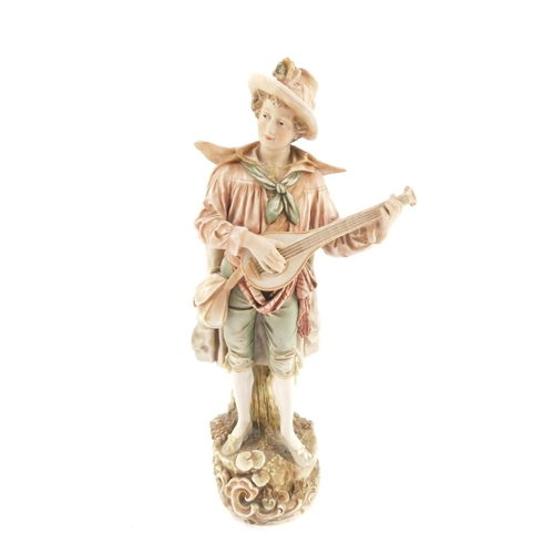 42 - A Royal Dux porcelain figure of a lute player, No 141, modelled standing in rustic costume, on a nat...