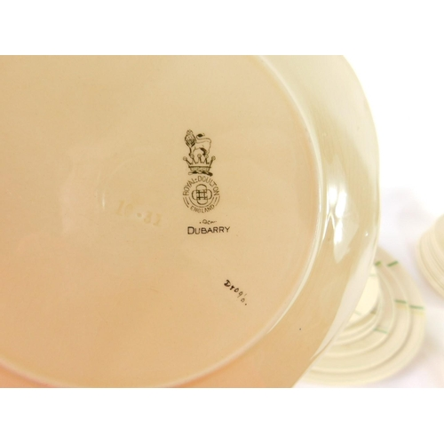 54 - An early 20thC Royal Doulton pottery part dinner service decorated in the Dubarry pattern, D5091, co...