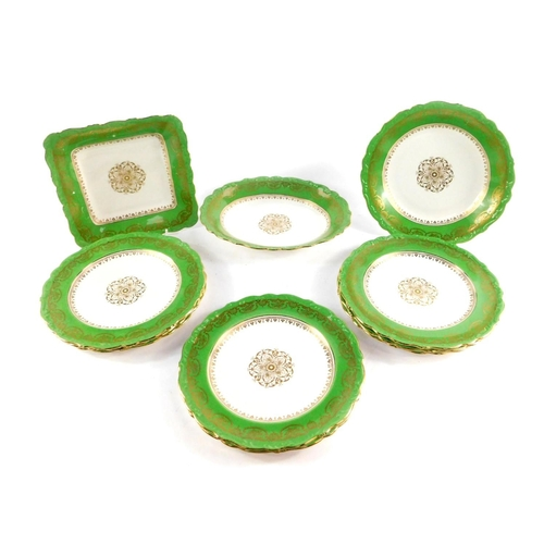 55 - An early 20thC Shelley porcelain part dessert service, gilt decorated against a green border, compri...