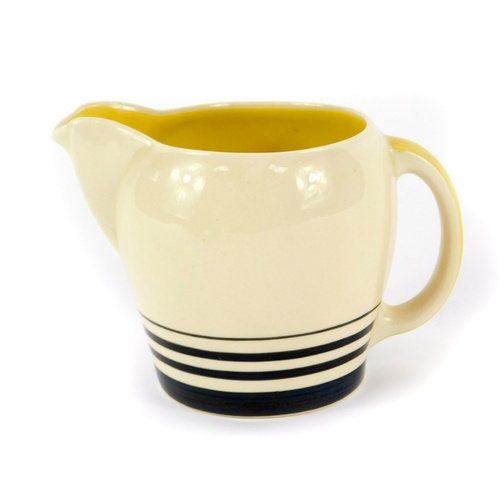 41A - A Susie Cooper Art Deco cream jug, with graduated banded decoration, printed marks and moulded '30',...
