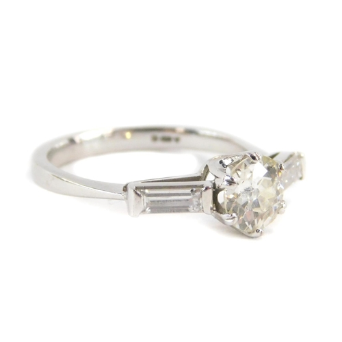 1 - An 18ct white gold three stone diamond ring, with a central round brilliant cut diamond approx 0.83c...