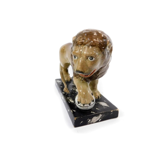 17 - A late 18thC Ralph Wood Staffordshire pottery figure of The Medici Lion, modelled standing with his ...