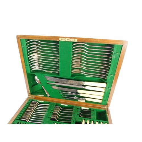 18 - A Walker & Hall oak cased silver plated canteen of cutlery, decorated in the Old English pattern, th...