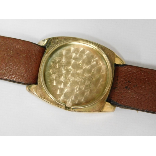 8 - A 1920's gentleman's Rolex wristwatch, with silvered Rolex dial, seconds dial and blue hands, 2.5cm ...