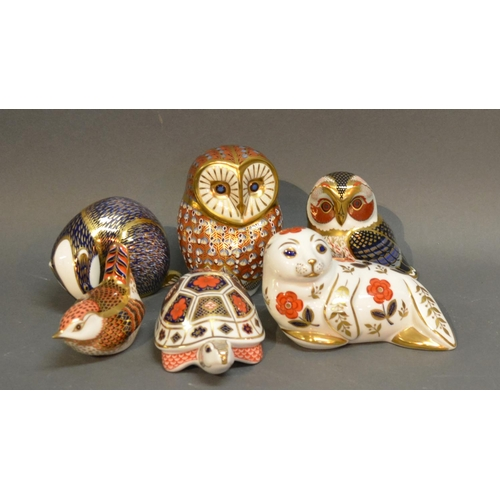 9 - A Royal Crown Derby Decanter In The Form Of An Owl, together with five other similar Royal Crown Der...