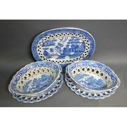12 - A Pair Of 18th Century Creamware Oval Baskets On Stands of pierced form decorated in under-glazed bl...