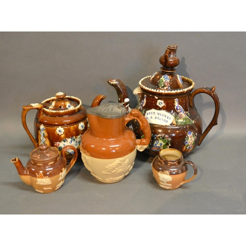 14 - A Bargeware Large Teapot Decorated In Relief, together with another similar and three stoneware harv...