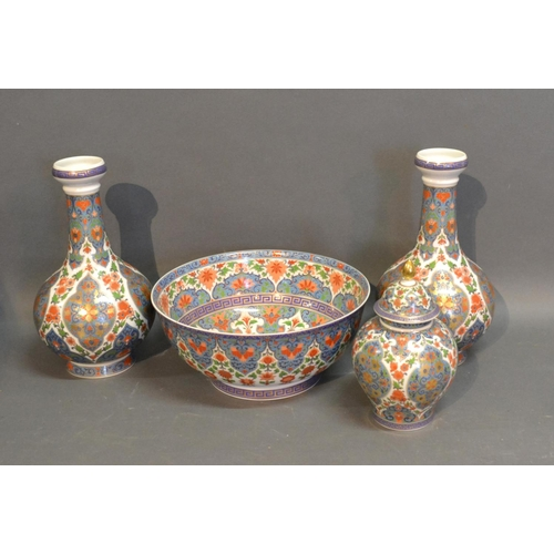 17 - A Kaiser Bowl Together With A Pair Of Matching Bottleneck Vases and a matching covered vase...