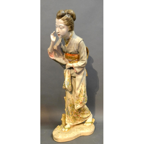 21 - A Japanese Satsuma Porcelain Figure In The Form Of A Lady, decorated in polychrome enamels highlight...