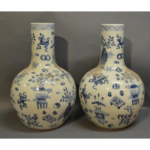 49 - A Pair Of Chinese Porcelain Large Bottle Neck Vases, decorated in under glaze blue, 59cm tall...