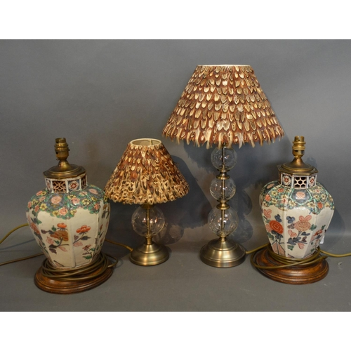 46 - A Glass Table Lamp With Feather Shade Together With Another Similar and a pair of porcelain table la...
