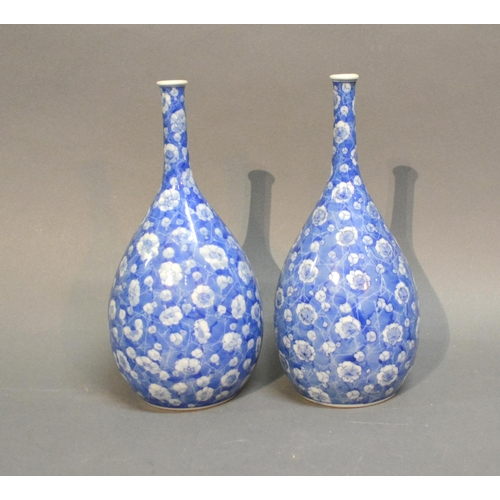 42 - A Pair Of Japanese Under Glazed Blue Decorated Bottle Neck Vases of Oviform, 24cm tall...