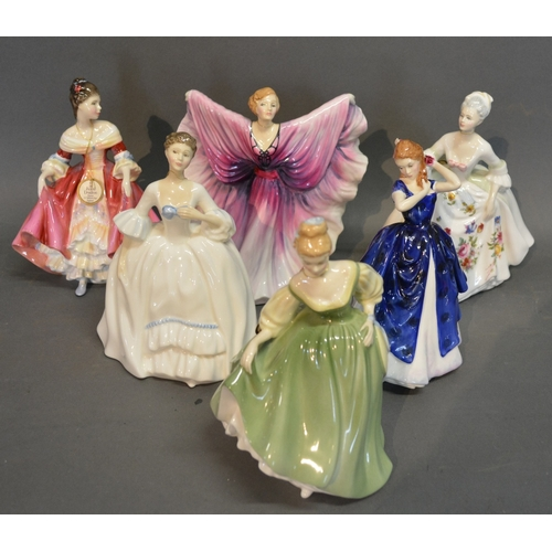 53 - A Royal Doulton Figurine Isadora HN2938, together with another Diana HN2488, another Southern Belle ...