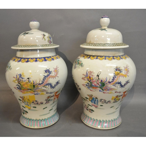 59 - A Pair of Canton Porcelain Covered Vases, decorated in polychrome enamels highlighted with gilt, 42c...