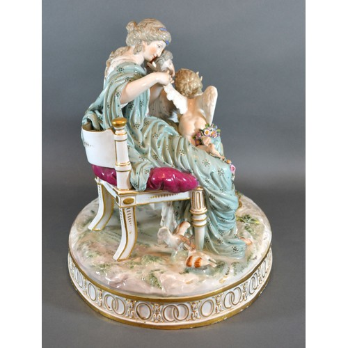33 - A Late 19th Century Meissen Porcelain Large Group in the form of Venus clipping the wings of Cupid d...