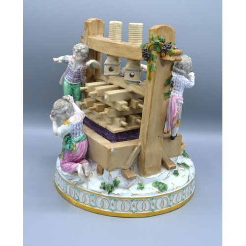 34 - A Late 19th Century Meissen Porcelain Group in the form of six figures around a wine press decorated...