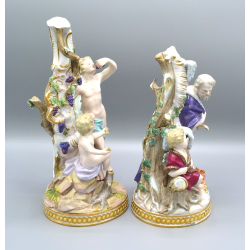 35 - A Pair of Meissen Porcelain Groups each decorated in polychrome enamels with figures and highlighted...