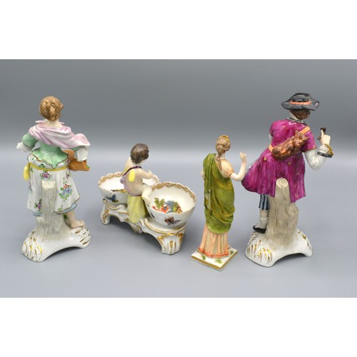 4 - A Berlin Porcelain Double Salt with putti surmount together with three German porcelain figures