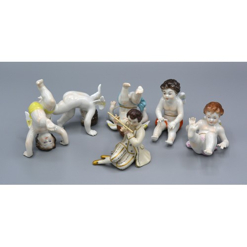 5 - A Group of Five German Porcelain Models of Putti together with a German porcelain model in the form ...