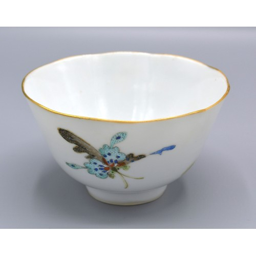 60 - A Chinese Porcelain Tea Bowl and Stand decorated with butterflies within a landscape, seal mark to b...