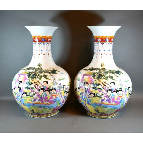49 - A Pair of Chinese Large Bottleneck Vases decorated in polychrome enamels with figures amongst landsc...