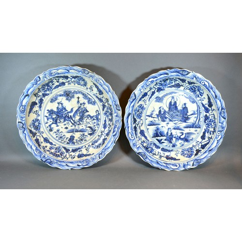 50 - A Pair of Chinese Underglaze Blue Decorated Large Chargers, each decorated with figures within lands...