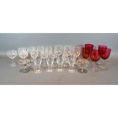 54 - Five Cranberry Glass Pedestal Glasses together with a small set of glasses, four tapered glasses and...