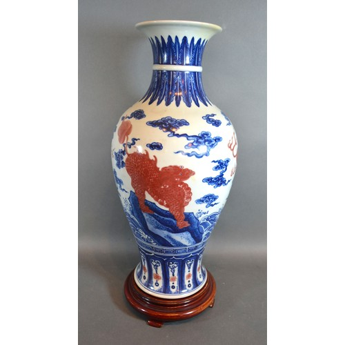 57 - A Chinese Porcelain Oviform Vase decorated with iron red Fu dogs with underglaze blue six character ...