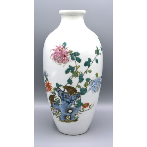 59 - A Chinese Porcelain Oviform Vase decorated in polychrome enamels with birds amongst foliage, red sea...