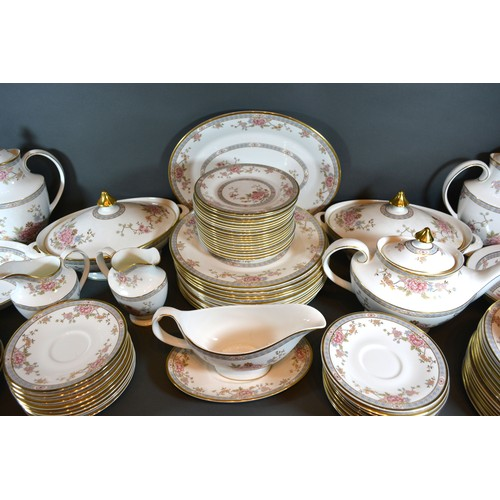 9 - A Royal Doulton Canton Pattern Tea Dinner and Coffee Service comprising coffee pot, teapot, plates, ...