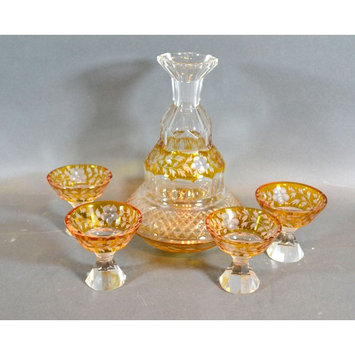 18 - A Victorian Glass Drinking Set comprising a decanter and four small glasses engraved with foliate de...