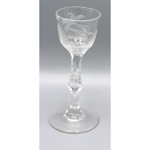 24 - An Early Engraved Tulip Shaped Cordial Glass with cut stem and circular foot, 15 cms tall
