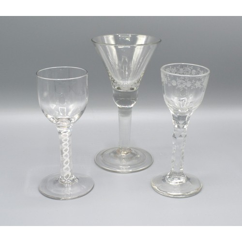 27 - An Early Engraved Cordial Glass with cut glass stem together with another similar with air twist ste...