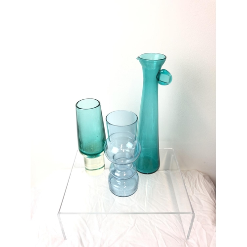 32 - Tamara Aladin for Riihimaki Lasi - A Petroleum Blue Cased Glass Vase, of tapered cylindrical form on...