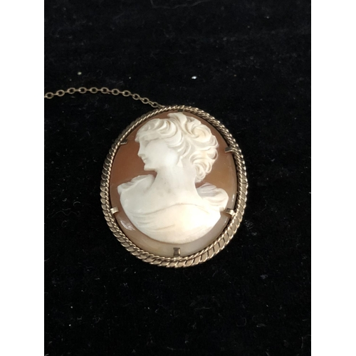42 - A 9ct yellow gold mounted cameo brooch, the oval cameo cut with a young lady, the mount of rope twis...