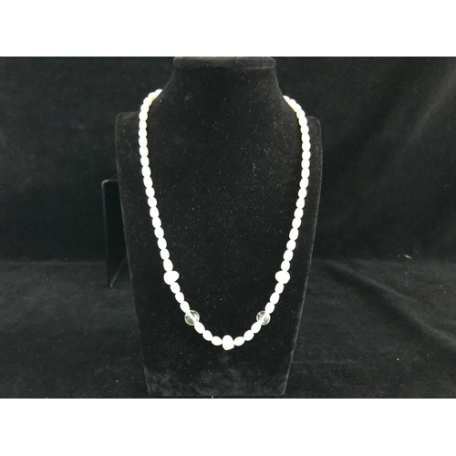 43 - A cultured freshwater pearl and rock crystal bead necklace, silver ring clasp stamped 925, 48cm long...