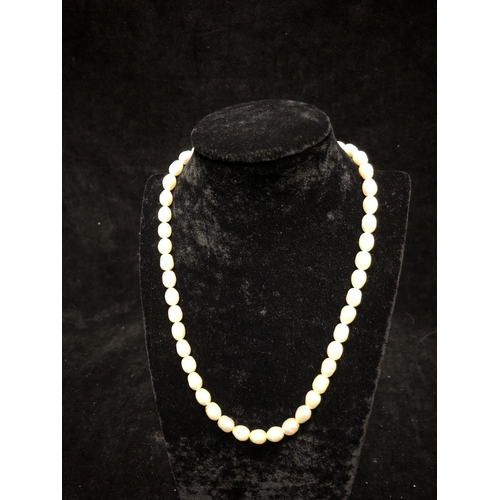 10 - A string of 46 oval pearls, 40cm long approx...
