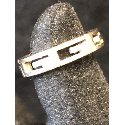 3 - Gucci - A white gold G logo unisex ring, formed as six G  openwork letters and a blank rectangle, st...