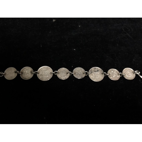A coin bracelet, composed of 8 British coins: 6 x 3d coins