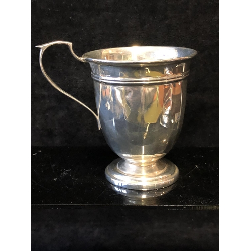 60 - A silver baby cup, panelled body with scroll handle and thumb-piece, Birmingham 1971, makers mark BE...