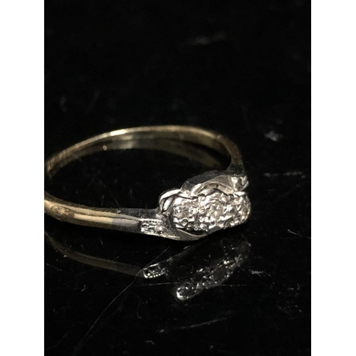 9 - A three stone diamond ring, the stones of 8 cut, star illusion setting and shoulders in  platinum, y...